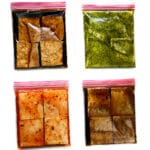 Four bags of tofu marinading in balsamic, cilantro lime, Thai chili, and sweet Asian marinades.