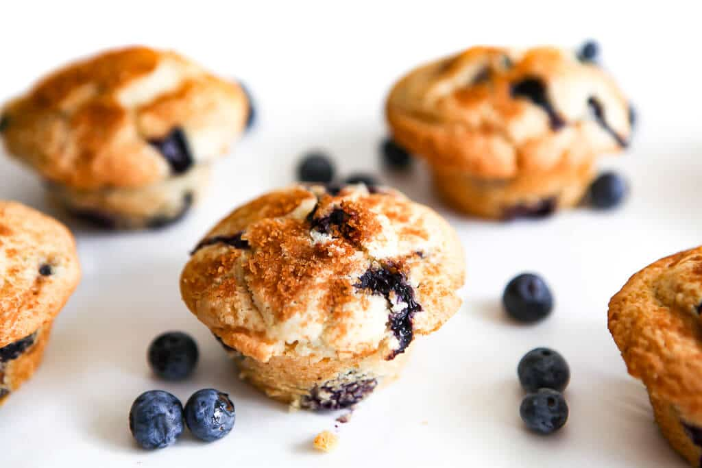 Blueberry muffins baked with cinnamon and sugar on the top.e