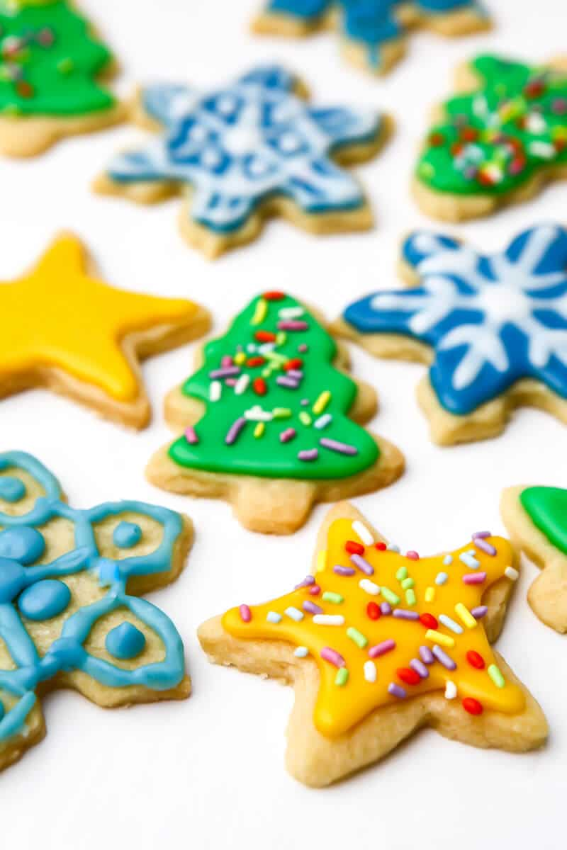 Vegan cut out cookies decorated with vegan royal icing in bright colors.