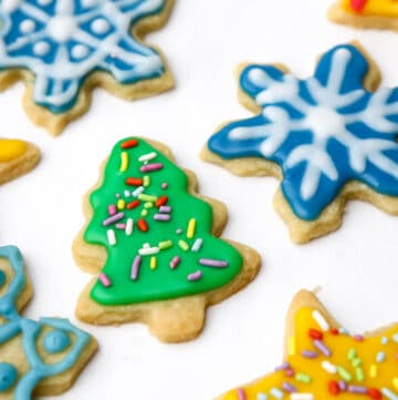 Cut out cookies in the shape of stars, Christmas trees, and snowflakes decorated with vegan royal icing.