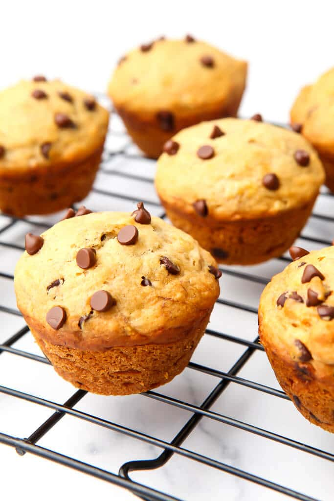 Chocolate chip banana muffins on a cooling wrack.