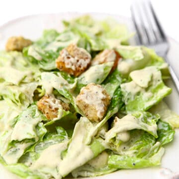 A close up of a plate full of vegan Caesar salad.